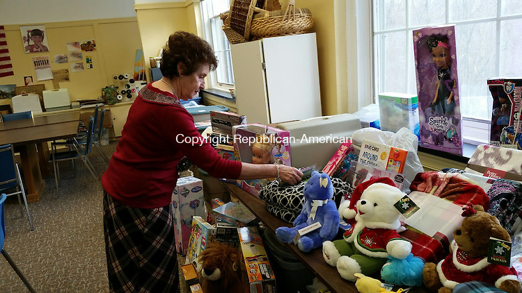 MIDDLEBURY, CT: 15 Dec. 2015:121515BB02: MIDDLEBURY ---- Social Services Director Jo-Ann Cappelletti places a donation on a table covered with toys. As Christmas gets closer, Cappelletti hopes donations of gifts for families in need pick up. Bill Bittar Republican-American