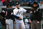 Reno Aces Manager Phil Nevin talks at the plate with El Paso Chihuahuas Manager Pat Murphy before the opening day game in Reno, Nev., on Thursday, April 3, 2014. <br /> Photo by Cathleen Allison