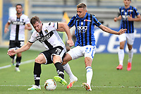 Riccardo Gagliolo of Parma and Timothy Castagne of Atalanta BC compete for the ball during the Serie A football match between Parma Calcio and Atalanta BC at Ennio Tardini stadium in Parma (Italy), July 28th, 2020. Play resumes behind closed doors following the outbreak of the coronavirus disease. Photo Andrea Staccioli / Insidefoto