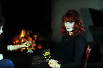 Flamin red head Florence Welch of 'Florence and the Machine' looks like Peig Sayers as she sups a hot whiskey by an open fire  in Corrig, Dingle at the weekend where she was recording three songs for the RTE programme Other Voices' . Hailed as a singing sensation Florence played to packed houses in Dublin and Cork with her unique voice and her own material.<br /> Picture by Don MacMonagle