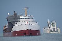 Great Lakes ship Frontenac pass Innovation on Lake Huron.