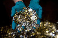 Tuesday 28 February 2017<br /> Pictured: A worker holds handfuls of the new one pound coin <br /> Re: The Royal Mint in Llantrisant is producing the new one pound coin