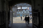 Looking out from Abbey Gate, Bury St Edmunds, Suffolk, England. Bury St Edmunds Abbey Great Gate is an impressive 14th century stone gatehouse of the Benedictine abbey and was designed to be the gateway for the Great Courtyard. One of the best surviving examples of its type, this two storey gate-hall is entered through a single archway which retains its portcullis.