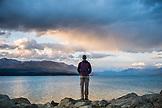 NEW ZEALAND, Aoraki Mount Cook National Park, Man Overlooking Lake Pukaki, Ben M Thomas
