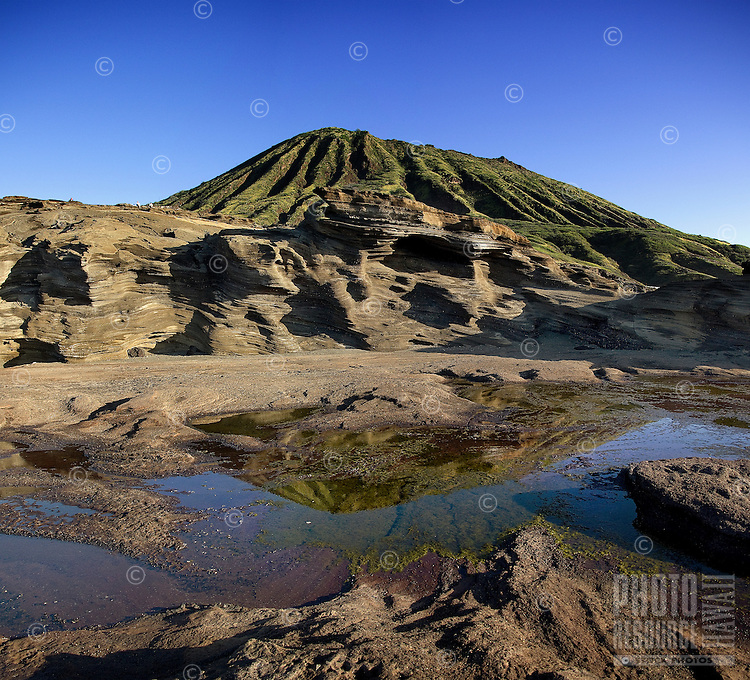 Beautiful view of Koko Crater reflecting in a tide pool from Lana'i Lookout, O'ahu