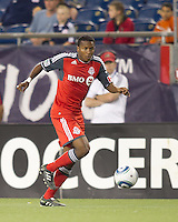 Toronto FC defender Danleigh Borman (25) dribbles down the wing. In a Major League Soccer (MLS) match, the New England Revolution tied Toronto FC, 0-0, at Gillette Stadium on June 15, 2011.