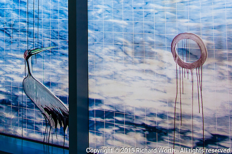 Oakland California artist Hung Liu has created a stunning glass mural:  Soaring red-crowned crane, to raise the spirits of weary travelers trudging through a terminal at the Oakland International Airport, Oakland, California.
