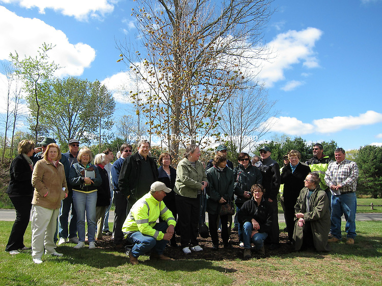 SOUTHBURY, CT - 27 April 2012 - 042712MR01 - A group of family and friends of residents who died in the past year gather around a new sugar maple tree planted at Community House Park as part of the town's Arbor Day celebration on Friday. The tree was dedicated to the memory of 30 residents. MATTHEW O'ROURKE/ REPUBLICAN-AMERICAN