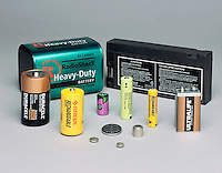 A VARIETY BATTERIES<br /> (l-r) 6V Zinc Carbon Lantern, 12V Sealed Lead-Acid Rechargeable Radio, Alkaline D rechargeable Ni-Cad C, high energy 3.6V lithium camera, 1.2V rechargeable nickel metal hydride, rechargeable AAA ni-cad, 9V lithium powercell, Zinc-mercury oxide hearing aid, lithium photos & tiny zinc-air hearing aid.