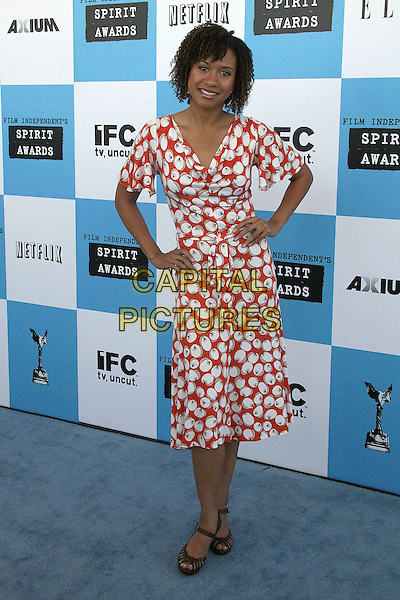 TRACIE THOMS.2007 Film Independent's Spirit Awards at the Santa Monica Pier, Santa Monica, California, USA,.24 February 2007..full length red and white print patterne dress hands on hip.CAP/ADM/BP.©Byron Purvis/AdMedia/Capital Pictures.