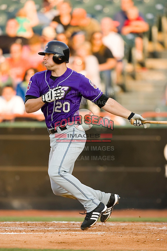 Catcher Chris Gimenez (20) of the Akron Aeros follows through on his swing at Prince Georges Stadium in Bowie, MD, Tuesday June 17, 2008.