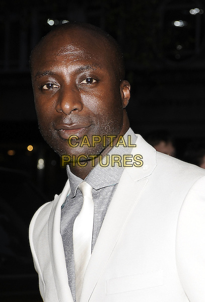OZWALD BOATENG.Nicky Haslam's book launch party, Westbury Hotel, London, England. .April 21st, 2010 .headshot portrait white suit jacket blazer grey gray boateng.CAP/CAN.©Can Nguyen/Capital Pictures.