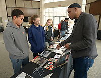 NWA Democrat-Gazette/ANDY SHUPE<br /> Asa Poole (from left), 12; Meg Gebhart, 12; and Kennedy Phelan, 13; all seventh-graders at Ramay Junior High School in Fayetteville, listen Friday, Feb. 9, 2018, as curator Khalid el-Hakim of Detroit explains the history behind artifacts on display while visiting the Black History 101 Mobile Museum inside the Janelle Y. Hembree Alumni House on the University of Arkansas campus in Fayetteville. A selection of 200 items from a collection of more than 7,000 artifacts from black history in the U.S. was hosted by the Sam M. Walton College of Business Office of Diversity and Inclusion and The Visionairi Foundation.