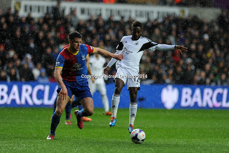 Swansea city's Nathan Dyer ® is challenged by Scott Dann. Barclays Premier league, Swansea city v Crystal Palace match at the Liberty Stadium in Swansea, South Wales on Sunday 2nd March 2014.