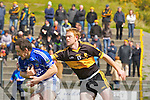 Colm Cooper Dr Crokes knocks the ball away from Pa Sheehan Laune Rangers during their Club Championship semi final in Killarney on Sunday