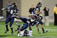 8 November 2008:  FIU running back Dante Owens (8) is upended in the first quarter of the FIU 22-21 victory over Arkansas State at FIU Stadium in Miami, Florida.