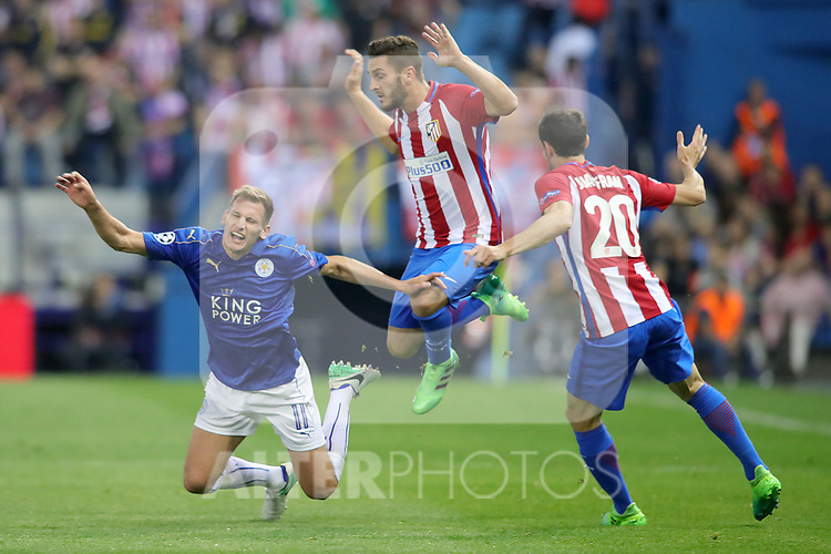 Atletico de Madrid's Koke Resurrecccion (c) and Juanfran Torres (r) and Leicester City FC's Marc Albrighton during Champions League 2016/2017 Quarter-finals 1st leg match. April 12,2017. (ALTERPHOTOS/Acero)