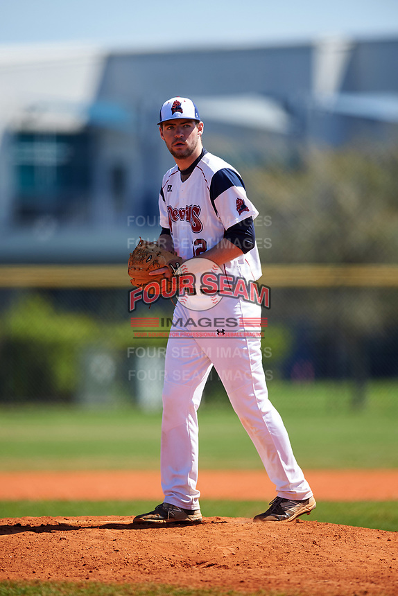FDU-Florham Devils starting pitcher Brad Norris (12) gets ready to deliver a pitch during the first game of a doubleheader against the Farmingdale State Rams on March 15, 2017 at Lake Myrtle Park in Auburndale, Florida.  Farmingdale defeated FDU-Florham 6-3.  (Mike Janes/Four Seam Images)