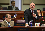 Nevada Assembly Republicans Paul Anderson, left, and Ira Hansen work on the Assembly floor at the Legislative Building in Carson City, Nev., on Friday, April 3, 2015. <br /> Photo by Cathleen Allison
