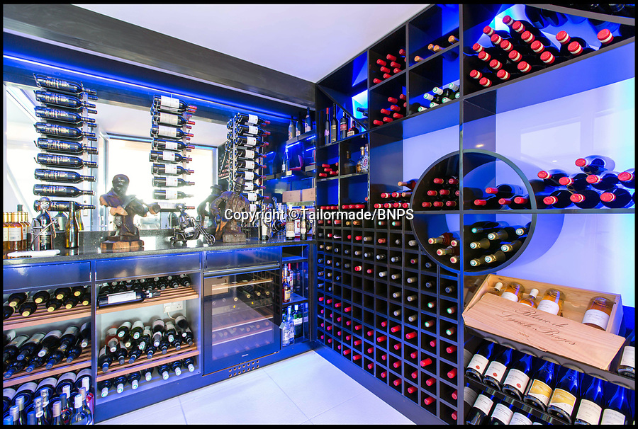 BNPS.co.uk (01202) 558833<br /> Pic: Tailormade/BNPS<br /> <br /> Climate controlled wine cellar..<br /> <br /> This state of the art mega-home is for sale on the exclusive millionaires playground of Sandbanks in Poole, Dorset.<br /> <br /> The biggest, most expensive, and luxurious home ever to come on the market on the tiny peninsula, it is now selling for a cool £8.75m.<br /> <br /> Called The Moorings, the harbour front mansion has stunning sea views, and is on one of the most enviable plots on Millionaire's Row.<br /> <br /> Its owners, entrepreneur Chris Thomas and wife Sue, spent a staggering £5.5m building the palatial home that has been compared to a five star hotel.<br /> <br /> Spread over 13,000 sq ft - the equivalent size of seven detached houses - the state-of-the art property comes with five en suite bedrooms, three reception rooms, an office, cinema room, indoor swimming pool, sauna, gym, gate house and boat house.