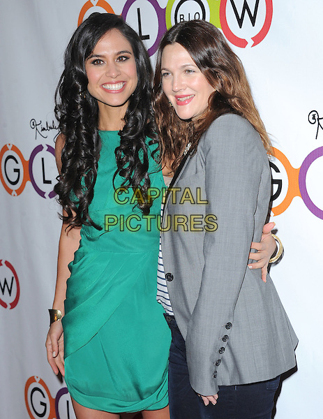 Kimberly Snyder & Drew Barrymore.The Opening of Kimberly Snyder's Glow Bio in West Hollywood in West Hollywood, California,.November 14th, 2012.half length black grey gray white lapels blazer green dress side .CAP/DVS.©DVS/Capital Pictures.