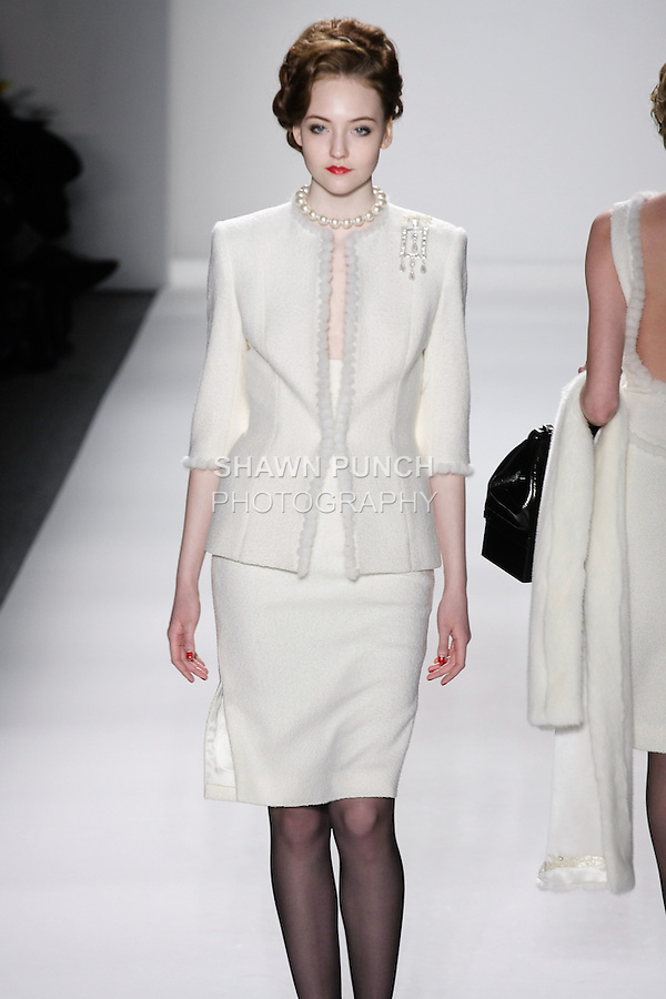 "Model walks runway in an ivory wool boucle princess skirt suit seamed w/mink-chain-mink stole, from the Zang Toi Fall 2012 ""Glamour At Gstaad"" collection, during Mercedes-Benz Fashion Week New York Fall 2012 at Lincoln Center."