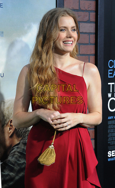 "Amy Adams.""Trouble With The Curve"" Los Angeles Premiere held at the Regency Village Theatre, Westwood, California, USA..September 19th, 2012.half length dress red gold bag purse .CAP/ROT/TM.©Tony Michaels/Roth Stock/Capital Pictures"