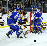 SIOUX FALLS, SD - MARCH 24: Scott Perunovich #7 for Minnesota Duluth looks to the puck with Trevor Stone #9 and Ben Kucera #14 from Air Force during their game at the 2018 West Region Men's NCAA DI Hockey Tournament at the Denny Sanford Premier Center in Sioux Falls, SD. (Photo by Dave Eggen/Inertia)