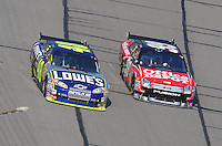 Sept. 28, 2008; Kansas City, KS, USA; Nascar Sprint Cup Series driver Jimmie Johnson (48) races alongside Carl Edwards (99) during the Camping World RV 400 at Kansas Speedway. Mandatory Credit: Mark J. Rebilas-