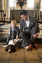 Matching outfits - Lee White and three year old Tyler White with Chester. <br />