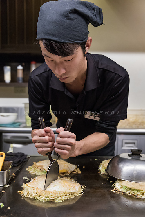 Hiroshima, Japan, February 7 2017 - Hiroshima style Okonomiyaki.