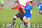 Tralee Dynamos Adam Pigott holds of the challenge of Ballyhar Dynamos Sean O'Sullivan at Cahermoneen, Tralee on Sunday.