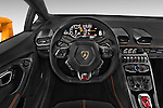 Car pictures of steering wheel view of a 2015 Lamborghini Huracan LP 6104 2 Door Coupe Steering Wheel