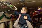 THOMASTON, CT. 08 December 2018-120818 - Bobby Dwyer, 4, of Torrington puts away his personal items above as he boards the The Northern Lights Limited train which will visit with Santa and his elves at the Railroad Museum of New England in Thomaston on Saturday. Bill Shettle Republican-American