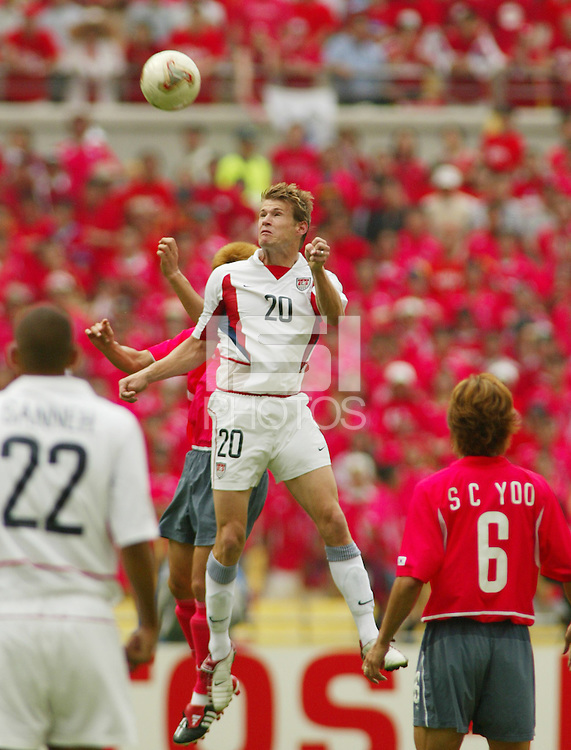 Brian McBride leaps for a header. The USA tied South Korea, 1-1, during the FIFA World Cup 2002 in Daegu, Korea.