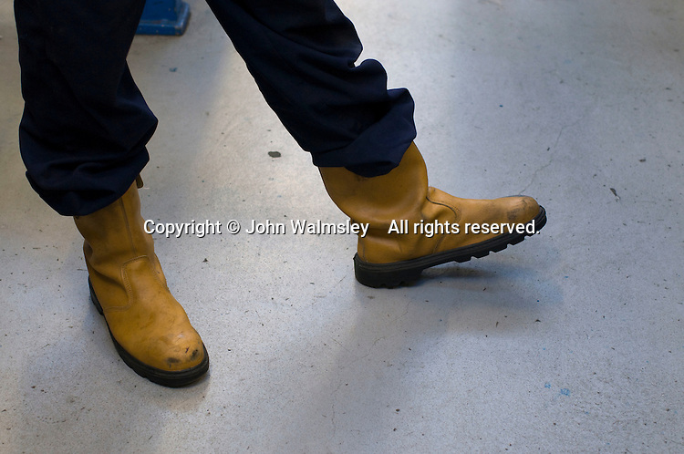 Safety boots with steel toecaps.    Apprentice engineering students at Kingston College..