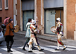 Costumed street performers roam the city during Carnivale in Rome, Italy.