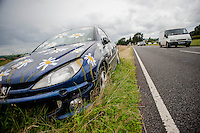 Tuesday 08 July 2014<br /> Pictured: The Daisy painted Car on the side of the road<br /> Re: When it comes to abandoned cars, most people will tut and say what a disgrace it is, leaving vehicles on public beauty spots.<br /> <br /> But one budding artist from Carmarthenshire has taken matters  into their own hands this week, to spruce up a blue Peugeot left on Carregsawdde Common in LLangadog, Carmarthenshire, West Wales<br /> Neither the police nor the council have had the authority to move the car, so it looks like someone has  attempted some daisy camouflage to help it blend in a little with the green surroundings!