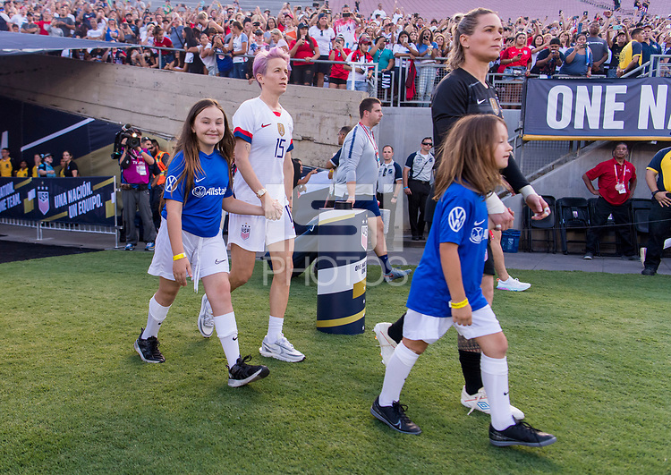 PASADENA, CA - AUGUST 4: Megan Rapinoe #15 and Ashlyn Harris #18 walk out on the field during a game between Ireland and USWNT at Rose Bowl on August 3, 2019 in Pasadena, California.