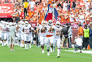 Landover, MD - September 1, 2018: Texas Longhorns defensive back P.J. Locke III (11) leads the team onto the field before game between Maryland and No. 23 ranked Texas at FedEx Field in Landover, MD. The Terrapins upset the Longhorns in back to back season openers with a 34-29 win. (Photo by Phillip Peters/Media Images International)