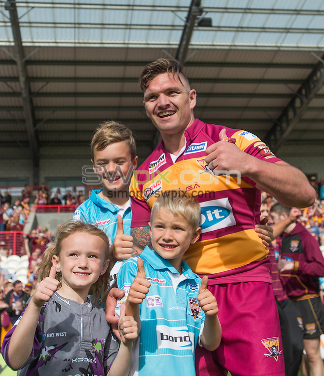 Picture by Allan McKenzie/SWpix.com - 24/09/2016 - Rugby League - First Utility Super League - The Qualifiers - Hull KR v Huddersfield Giants - KC Lightstream Stadium, Hull, England - Huddersfield's Danny Brough with children after his drop goal was the difference between his team and Hull KR as Huddersfield stay in Super League for 2017.