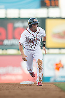 Jackson Williams (8) of the Richmond Flying Squirrels hustles towards third base against the Bowie Baysox at The Diamond on May 23, 2015 in Richmond, Virginia.  The Baysox defeated the Flying Squirrels 3-2.  (Brian Westerholt/Four Seam Images)