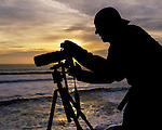 Photographer shooting the ocean at sunset, Point Reyes National Seashore, Marin County, California