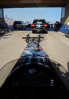 Jun. 29, 2012; Joliet, IL, USA: View from the car of NHRA top fuel dragster driver Shawn Langdon as he is towed to the starting line during qualifying for the Route 66 Nationals at Route 66 Raceway. Mandatory Credit: Mark J. Rebilas-