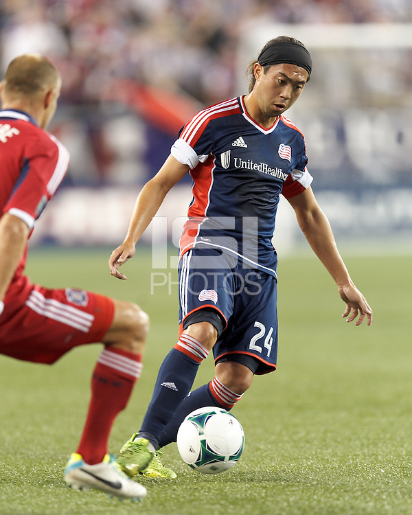 New England Revolution midfielder Lee Nguyen (24) dribbles. In a Major League Soccer (MLS) match, the New England Revolution (blue) defeated Chicago Fire (red), 2-0, at Gillette Stadium on August 17, 2013.