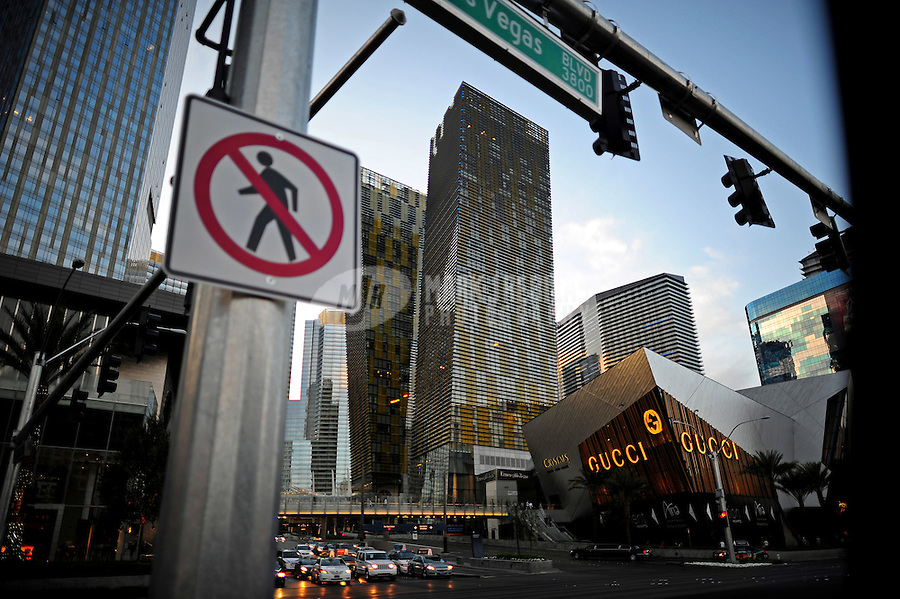 Las Vegas Blvd blvd road street traffic light no pedestrian walking sign building casino hotel high rise resort Gucci traffic stop Aria