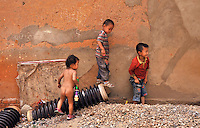 Children play in an migrant area known for child abductions in the suburbs of Kunming city.   Girls in China are increasingly targeted and stolen as there is a shortage of wives as the gender imbalance widens with 120 boys for every 100 girls..PHOTO BY SINOPIX