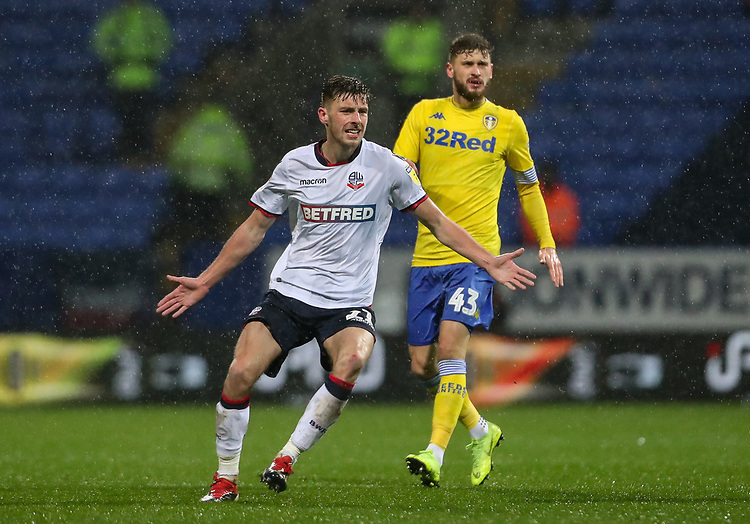 Bolton Wanderers' Joe Williams ahead of Leeds United's Mateusz Klich<br /> <br /> Photographer Andrew Kearns/CameraSport<br /> <br /> The EFL Sky Bet Championship - Bolton Wanderers v Leeds United - Saturday 15th December 2018 - University of Bolton Stadium - Bolton<br /> <br /> World Copyright © 2018 CameraSport. All rights reserved. 43 Linden Ave. Countesthorpe. Leicester. England. LE8 5PG - Tel: +44 (0) 116 277 4147 - admin@camerasport.com - www.camerasport.com