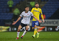 Bolton Wanderers' Joe Williams ahead of Leeds United's Mateusz Klich<br /> <br /> Photographer Andrew Kearns/CameraSport<br /> <br /> The EFL Sky Bet Championship - Bolton Wanderers v Leeds United - Saturday 15th December 2018 - University of Bolton Stadium - Bolton<br /> <br /> World Copyright &copy; 2018 CameraSport. All rights reserved. 43 Linden Ave. Countesthorpe. Leicester. England. LE8 5PG - Tel: +44 (0) 116 277 4147 - admin@camerasport.com - www.camerasport.com