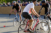 17 AUG 2014 - LONDON, GBR - A player from Six Feet Under lines up a shot during the game against Partisans at the 2014 London Open Bike Polo tournament in Highbury Fields in London, Great Britain (PHOTO COPYRIGHT © 2014 NIGEL FARROW, ALL RIGHTS RESERVED)
